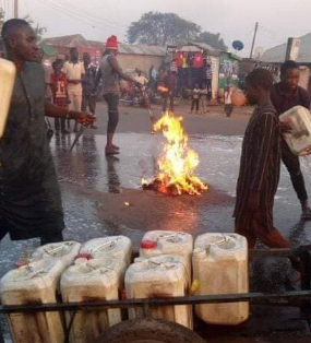 Photos: Kaduna state residents wash their streets with soap and water shortly after Governor El-Rufai's visit