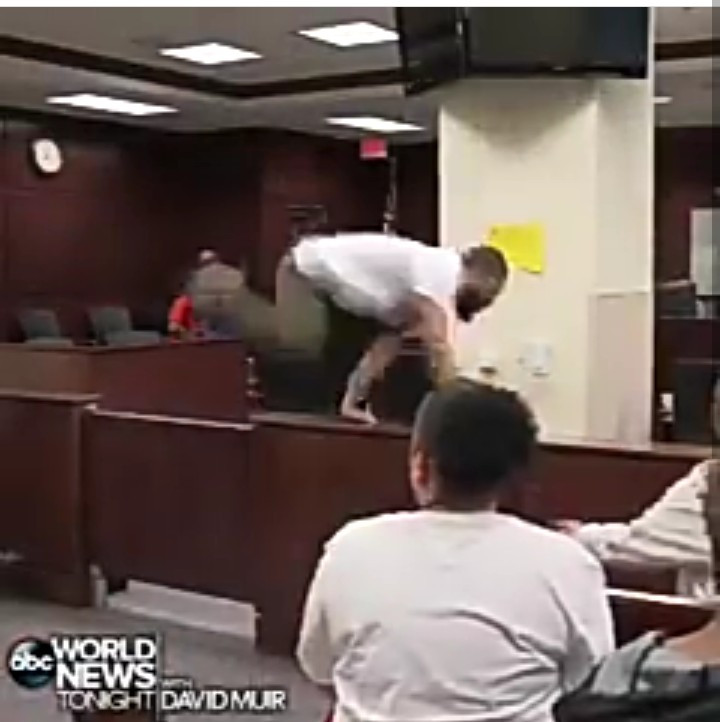 Video shows moment man reported to be son of murdered man rushed his father's suspected killer during court hearing