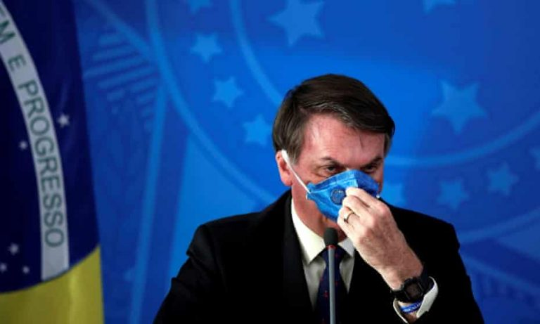 Bolsonaro says he 'wouldn't feel anything' if infected with Covid-19 and attacks state lockdowns