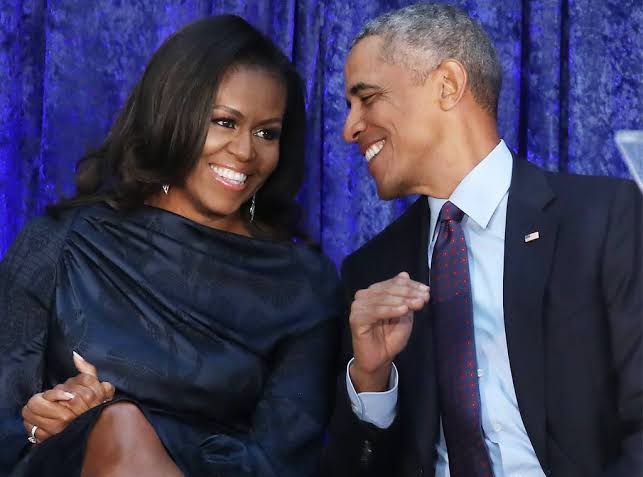 Michelle Obama tells graduates to focus their anger while Barack says the old normal wasn't good enough